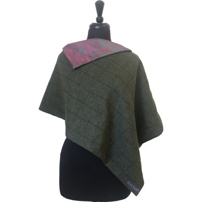 Clara poncho green/red/mint 3 quarter front view