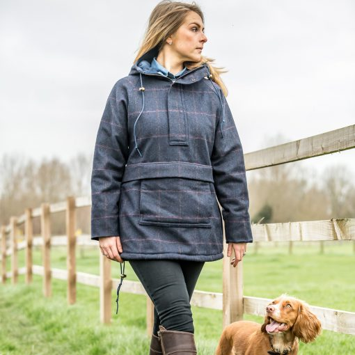 Bridie pictured in our Roberta smock - navy check colour option